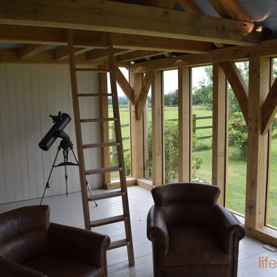 The Chappell oak-framed-cabin-life-space-cabinsFrame Interior image showing glass windows and oak frame | Life Space Cabins