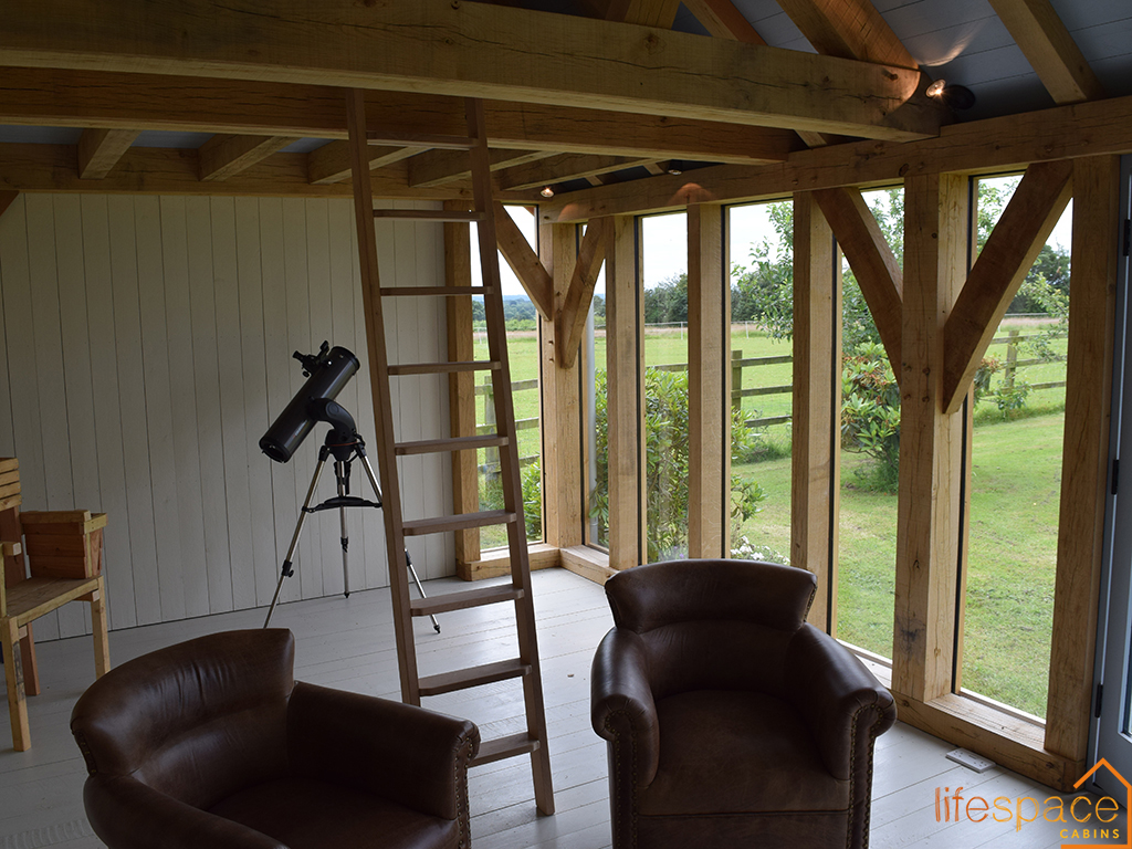 The Chappell oak-framed-cabin-life-space-cabinsFrame Interior image showing glass windows and oak frame   Life Space Cabins
