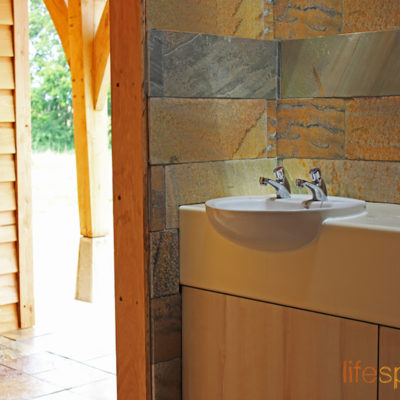 Innovative and practical washroom cabin on campsite showcasing natural materials and rustic charm. |Life Space Cabins