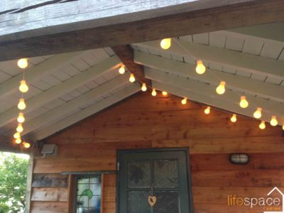 Festoon and Fairy Lights in the oak frame Alfresco Dining eating area |Life Space Cabins