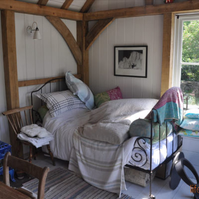 Garden Cabin showing oak frame and day bed