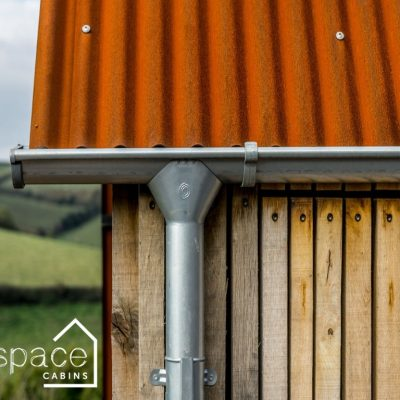 Luxury timber oak frame cabin with Cor ten roof and lindab guttering|Life Space Cabins