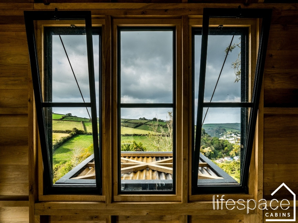 Bespoke luxury oak frame cabin with Crittall windows and view over River Dart in South Devon v |Life Space Cabins