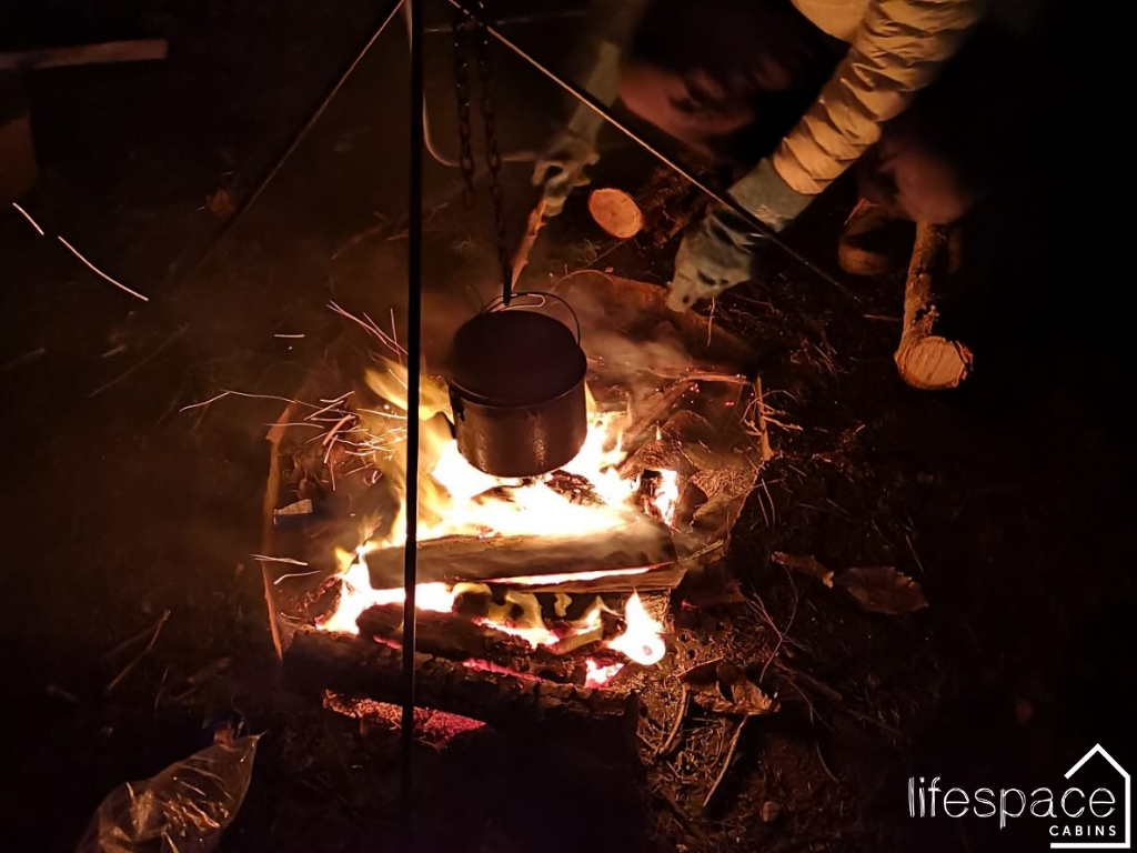 Keep Warm and eat by an Open Fire in our Woodland Cabin | Life Space Cabins