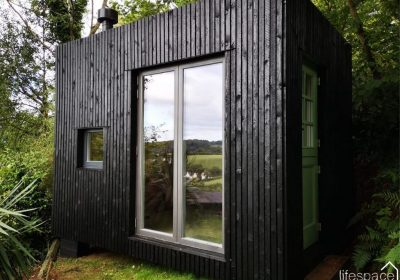 The Folly cabin, vertical timber cladding in black