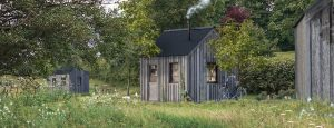 The timber Prairie Cabin in an orchard