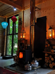 A woodland cabin interior with a woodburner